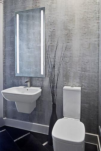Diseño de cuarto de baño con pared gris