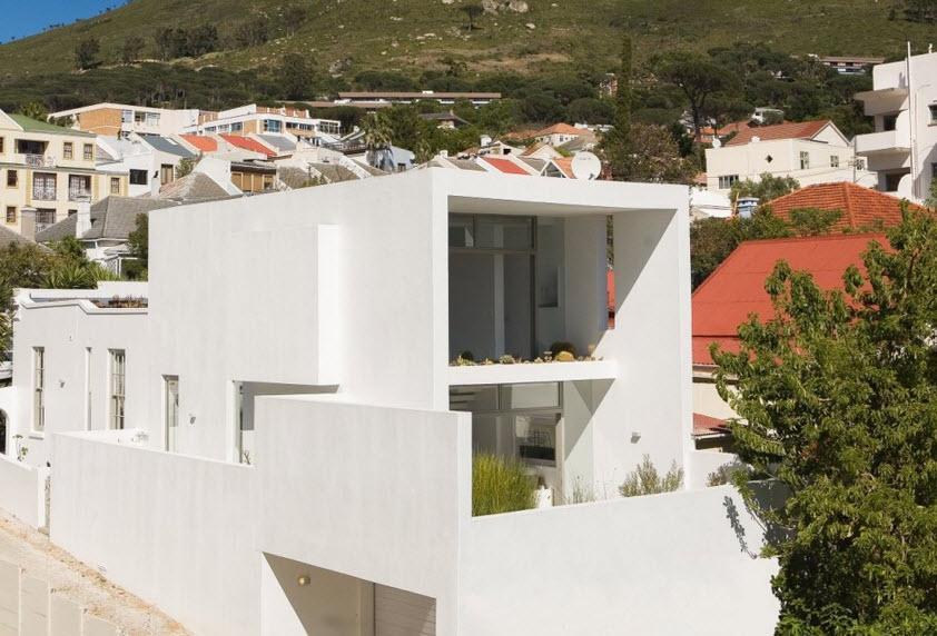 Dise o de casa angosta fachada y dise o de interiores for Disenos para frentes de casas