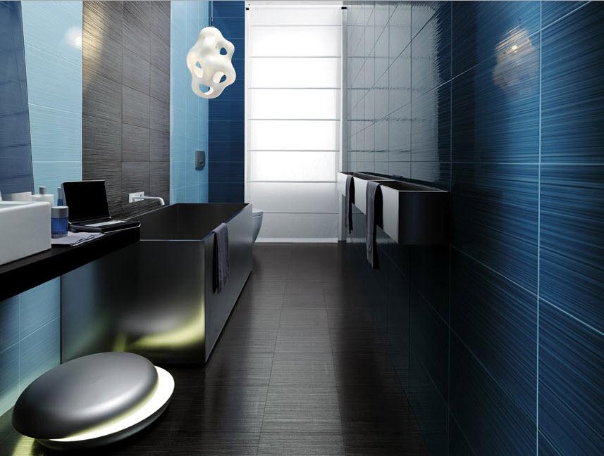 Baño Blanco Piso Gris:Cerámica negra, azul y celeste junto a una lámpara colgante