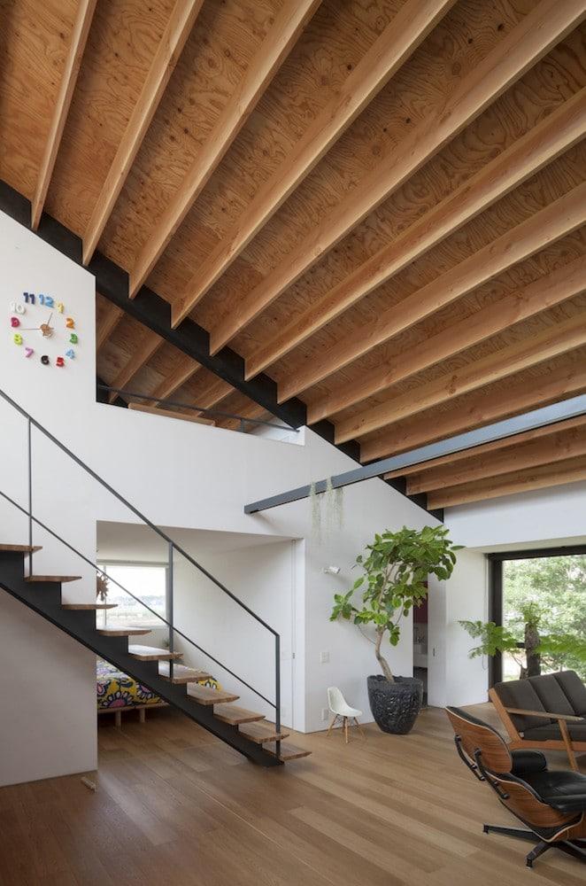 Dise o de casa moderna de un piso con techo en pendiente for Techos planos para casas