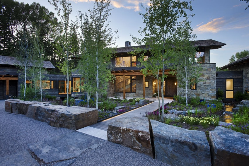 Dise o de casa de piedra fotos de fachada e interiores for Case di campagna moderne