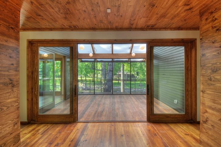 Dise o de interiores de madera de casa en la monta a - Interior casas de madera ...