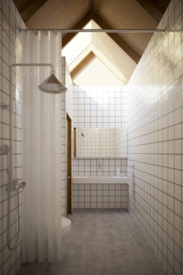 Diseño de cuarto de baño de techo a dos aguas