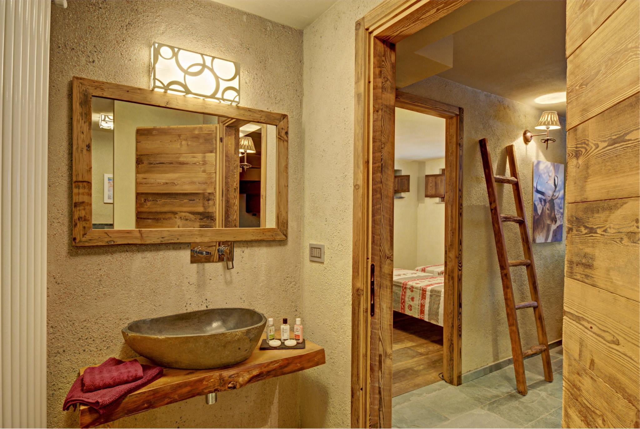 Dise o de interiores r stico uso de madera y piedra - Habitacion de madera ...