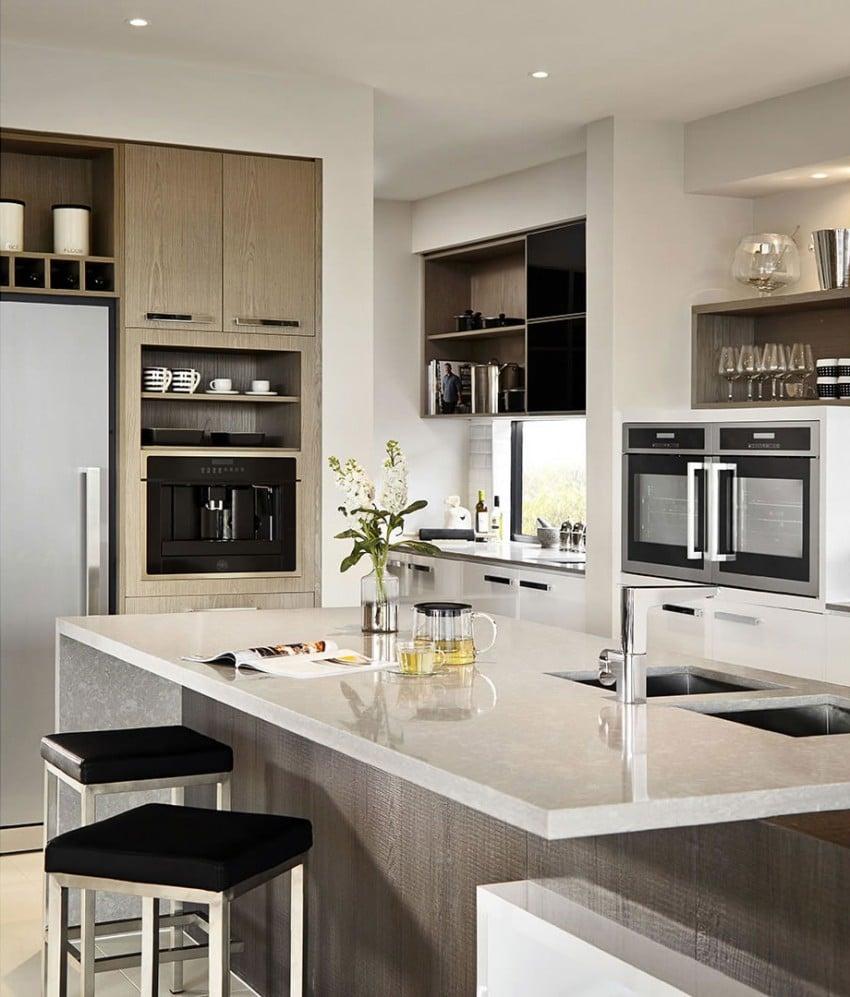 Casa de dos pisos moderna fachada y dise o de interiores for Cocinas modernas para apartamentos