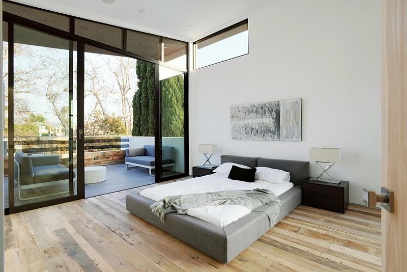 Dise o de casa moderna de dos pisos fachada e interiores for Ambientes de una casa moderna