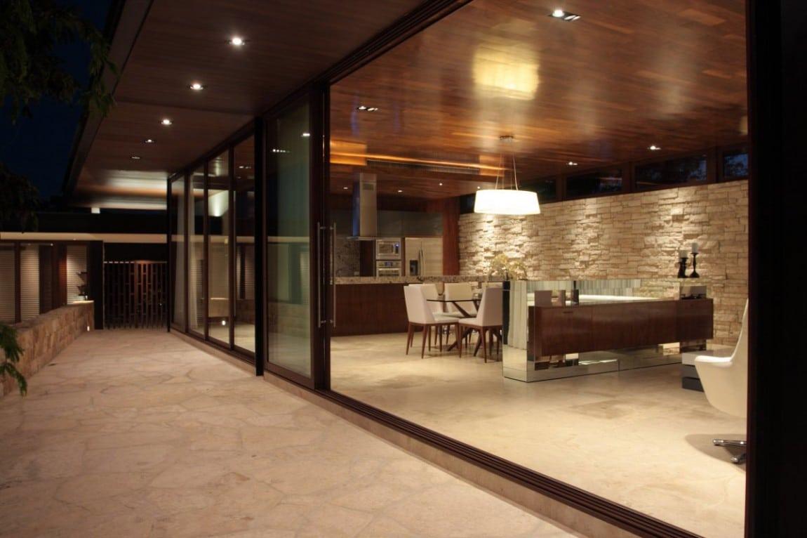 Dise o de casa en forma de l moderna fachada e interiores for Diseno de la casa interior