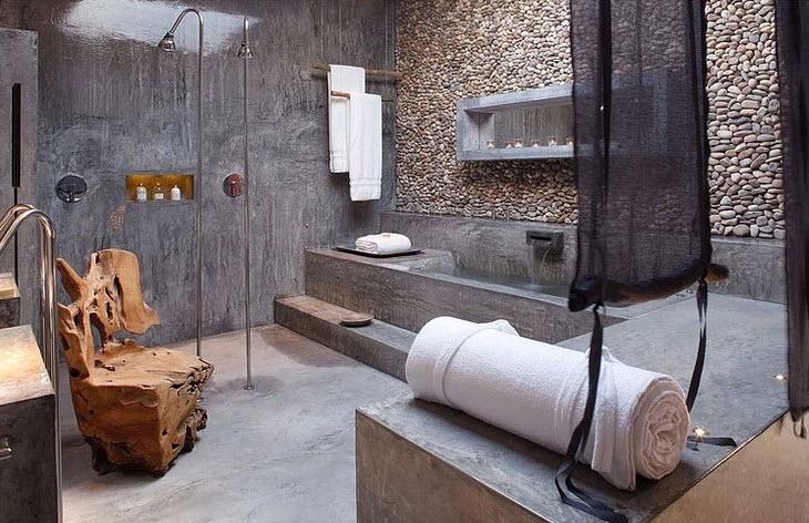 Tinas De Baño De Concreto: de cuarto de baño con pared de piedra rodada y pared de cemento