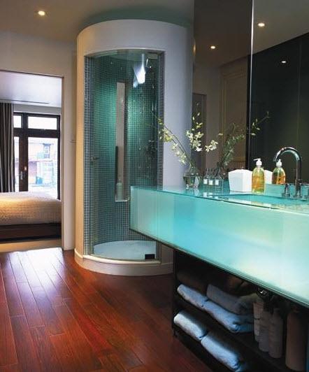 Iluminacion Cuarto Baño:El lavatorio parece un gran tanque de agua transparente y como está