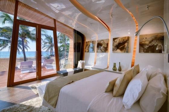 Dormitorio curvo  con vista al mar