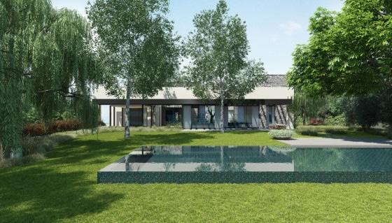 Fachada posterior de casa de un piso con piscina decorativa