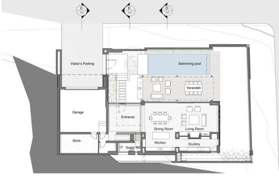 Plano de casa de dos pisos construido en terreno cuadrado
