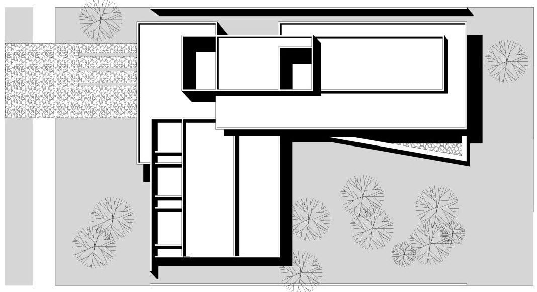 Dise o de casa en forma de l moderna fachada e interiores for Tipos de tejados de casas