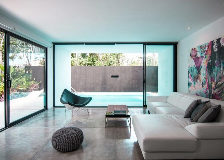 Dise o de casa minimalista de dos pisos planos y fachadas for Decoracion interior de casas minimalistas