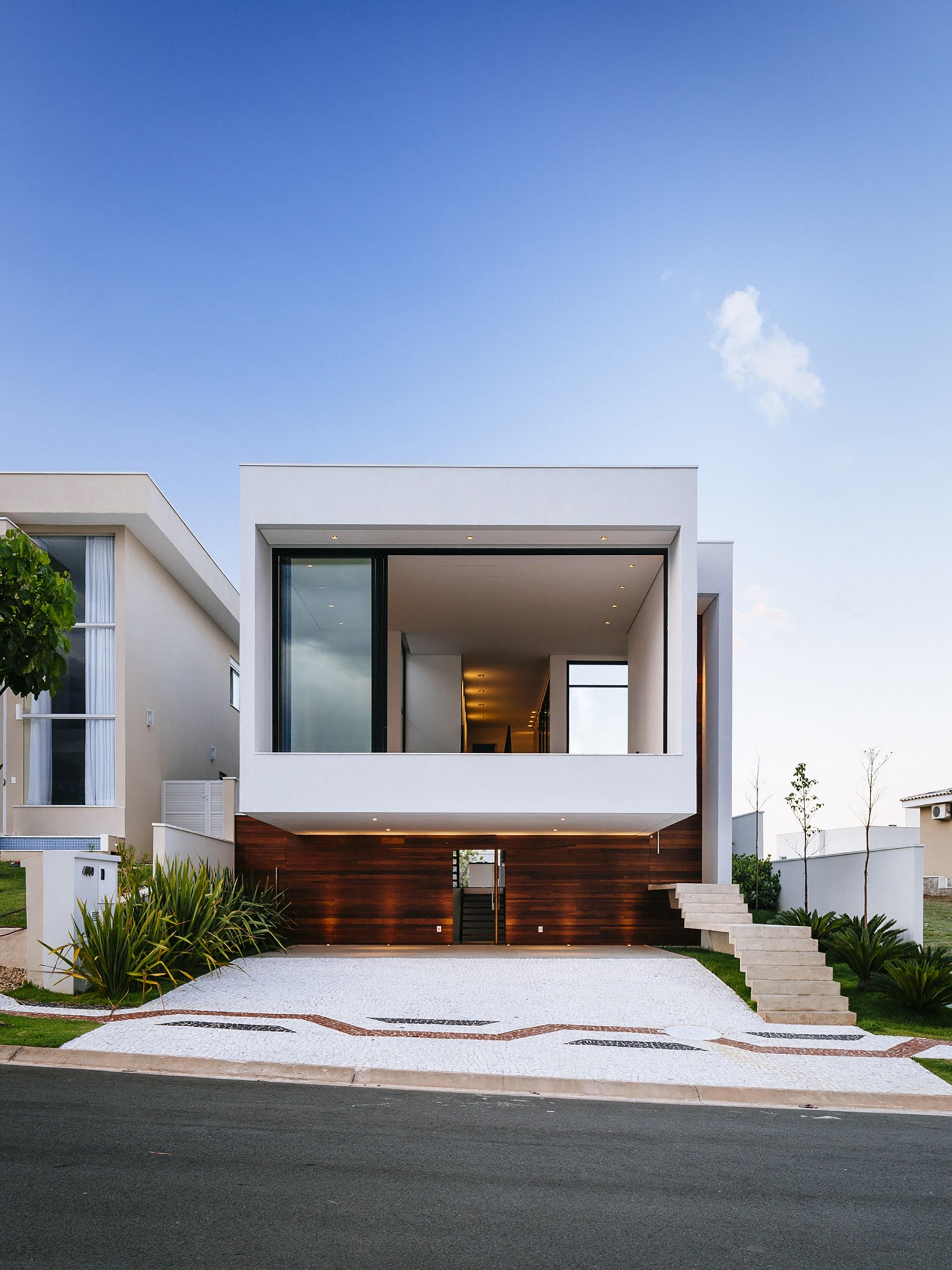 Dise o de moderna casa de dos pisos con fachada y planos for Pisos elegantes para casas