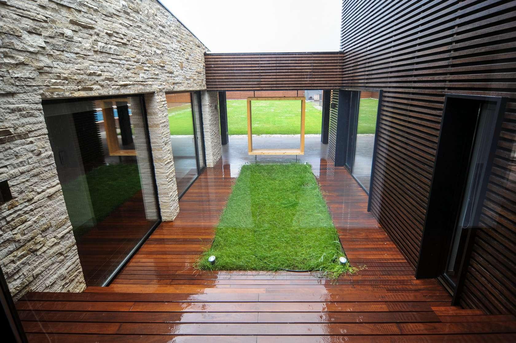 Jardines interiores modernos con piedras for Jardines modernos con piedras
