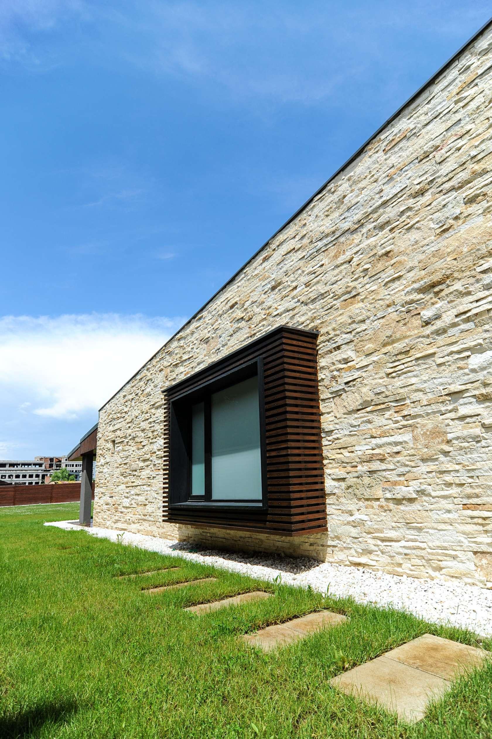 Dise o de casa moderna de dos pisos fachadas y planos - Construccion casas de piedra ...
