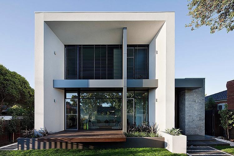 Dise o de casa moderna en esquina fachada e interiores for Fachadas de casas modernas 2 pisos