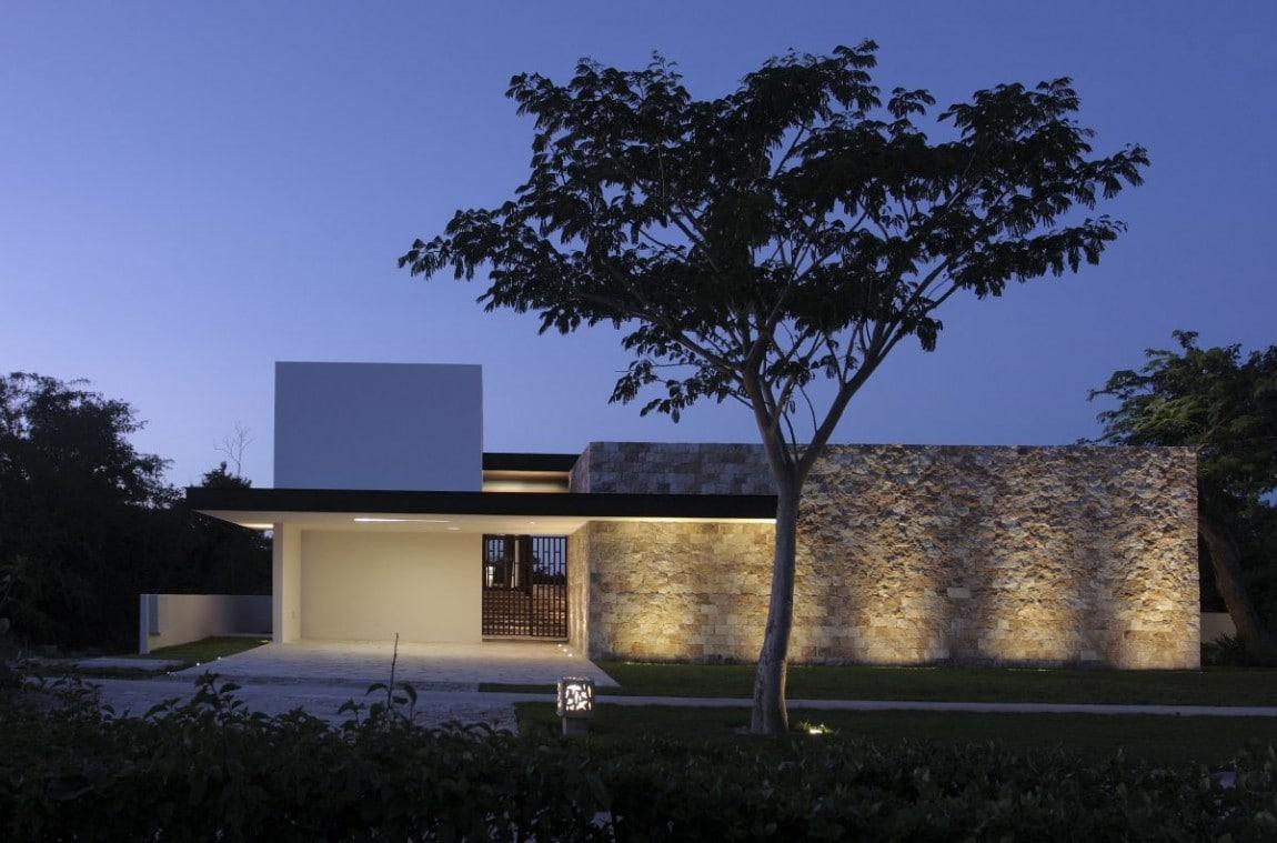 fachada de casa moderna en forma de l construye hogar