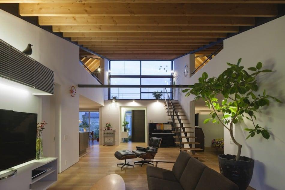 Dise o de casa moderna de un piso con techo en pendiente for Decoracion de casas interior modernas